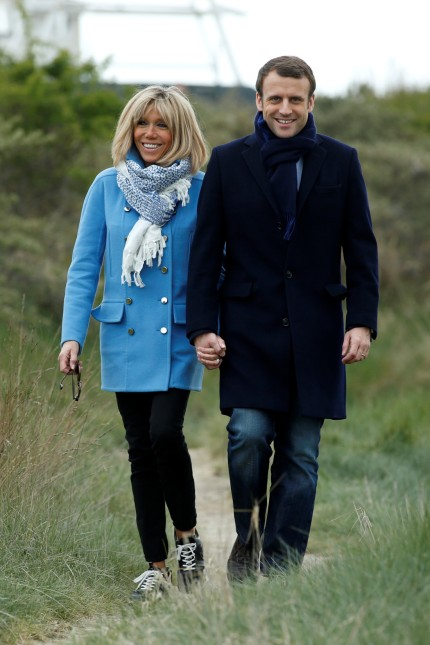 Emmanuel Macron, head of the political movement En Marche! (Onwards!) and candidate for the 2017 presidential election, and his wife Brigitte Trogneux pose for a photograph in Le Touquet