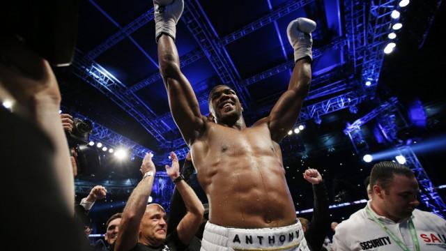 Anthony Joshua celebrates after winning the fight