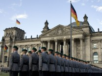 German armed forces Bundeswehr soldiers stand in formation during swearing-in ceremony in front of the Reichstag in Berlin