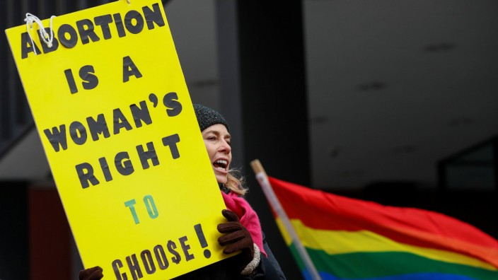 Anti-Trump demonstrator protests at abortion rights rally in Chicago