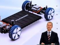 Volkswagen's brand chief Herbert Diess delivers his speech as Volkswagen presents a turnaround plan at a news conference in Wolfsburg