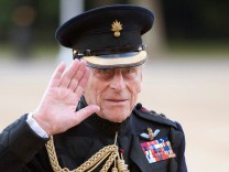 FILE PHOTO -  File photo of Britain's Prince Philip arriving on the eve of his birthday to take the salute of the Household Division Beating Retreat on Horse Guards Parade in London