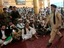 Afghan warlord Gulbuddin Hekmatyar arrives to give a speech to supporters in Jalalabad, Afghanistan