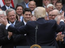 U.S. President Trump turns to Speaker Ryan as he gathers with Republican House members after healthcare bill vote at the White House in Washington