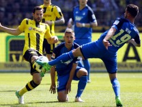 Borussia Dortmund's Sokratis Papastathopoulos in action with TSG Hoffenheim's Mark Uth