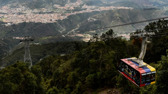 "Picture of a cable car of the new Merida cable car system, taken during its reinauguration on April 29, 2016 in the Venezuelan city of Merida. Venezuela reopened on Friday the Merida cable car system called ""Mukumbari"" -- the longest and highest route in"