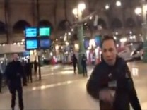 Still image taken from video shows police officers at the Paris' Gare du Nord train station
