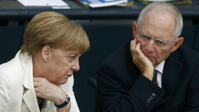 German Chancellor Merkel and Finance Minister Schauble attend a meeting at the Bundestag in Berlin
