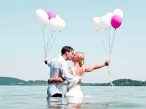 Germany Bavaria Tegernsee Wedding couple standing in lake kissing model released PUBLICATIONxINx