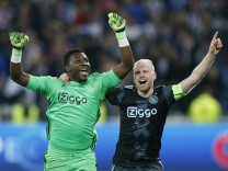 Ajax's Andre Onana and Davy Klaassen celebrate after the match