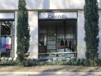 APTOPIX Chanel Store Robbery