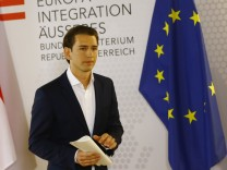 Austria's Foreign Minister Sebastian Kurz leaves a news conference in Vienna