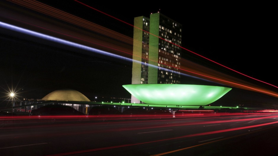 The Brazilian congress is lit up in the colours of the Brazilian national flag ahead of the 2014 World Cup, in Brasilia
