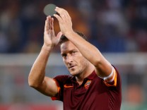 FILE PHOTO - AS Roma's Totti claps at the end of their Champions League Group E soccer match against CSKA Moskow at the Olympic Stadium in Rome