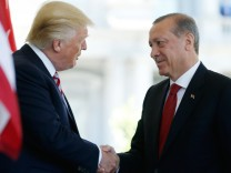 President Trump greets Turkey's President Erdogan at the entrance to the West Wing of the White House in Washington
