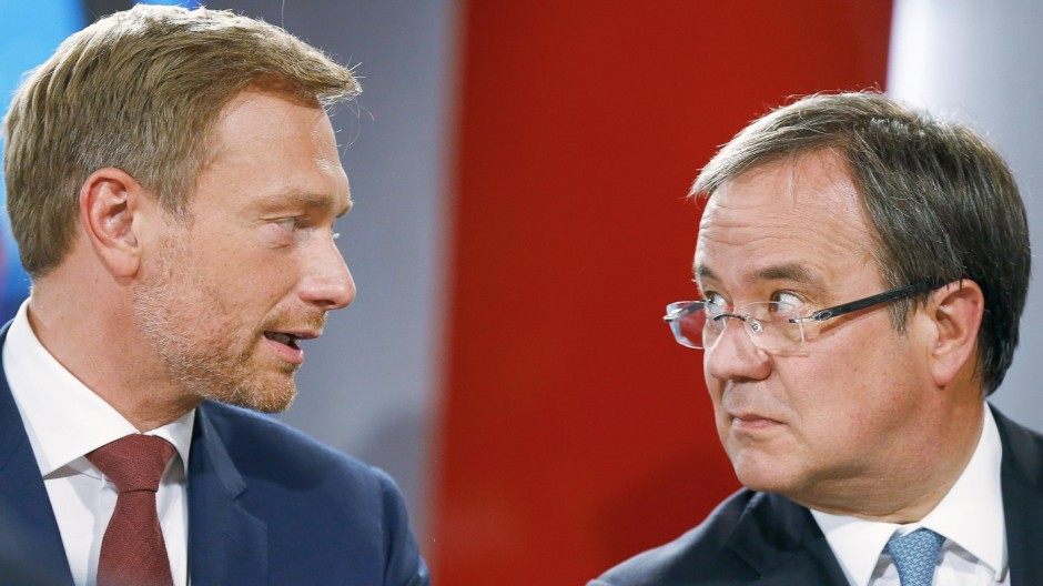 Christian Lindner, chairman of the liberal Free Democratic Party FDP and Armin Laschet, top candidate of the Christian Democratic Union (CDU) during a TV interview in Duesseldorf