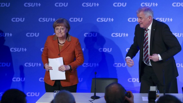 German Chancellor Merkel and Bavarian CSU leader Seehofer leave a news conference in Munich