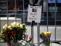 Flowers and a photograph of Alyssa Elsman, the 18-year-old woman who was killed on the sidewalk  is seen at a makeshift memorial at the scene of the incident outside the 3 Times Square building in Times Square in New York City