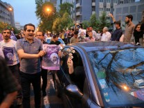 Supporters of Iranian president Hassan Rouhani celebrate his victory in the presidential election in Tehran