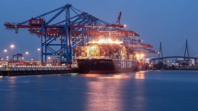 Containers are loaded onto a container ship at a shipping terminal in the harbour in Hamburg