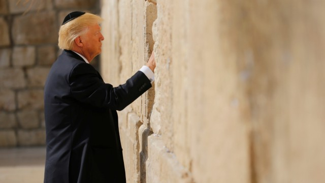 U.S. President Donald Trump places a note in the stones of the Western Wall, Judaism's holiest prayer site, in Jerusalem's Old City