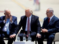 U.S. President Donald Trump sits next to Israel's Prime Minister Benjamin Netanyahu and Israel's President Reuven Rivlin during a welcoming ceremony upon his arrival at Ben Gurion International Airport in Lod near Tel Aviv