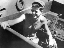 File handout image shows former U.S. President Kennedy aboard PT 109 boat during World War II