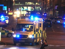 Emergency services at Manchester Arena after reports of an explosion at the venue during an Ariana G