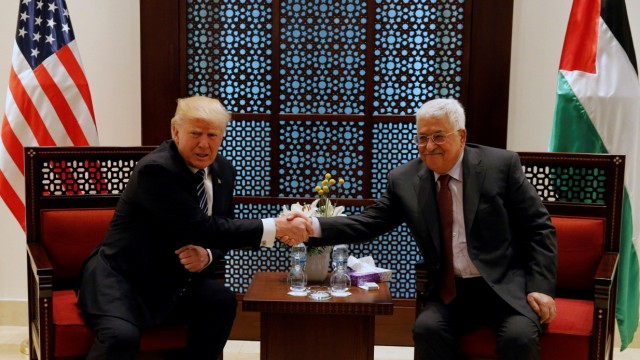 U.S. President Donald Trump shakes hands with Palestinian President Mahmoud Abbas during their meeting at the presidential headquarters in the West Bank town of Bethlehem