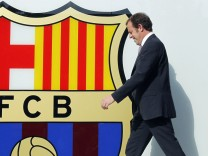 Neymar and Barcelona's president Sandro Rosell walk out to meet the media, after Neymar signed a five-year contract with FC Barcelona, at their offices close to Camp Nou stadium in Barcelona