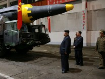 North Korean leader Kim Jong Un inspects the long-range strategic ballistic rocket Hwasong-12 (Mars-12)