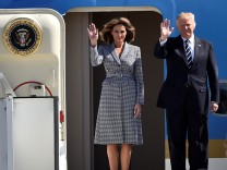 US President Donald Trump and first lady Melania Trump arrive at the Brussels Airport