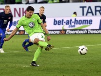 Wolfsburg's Mario Gomez scores their first goal from the penalty spot