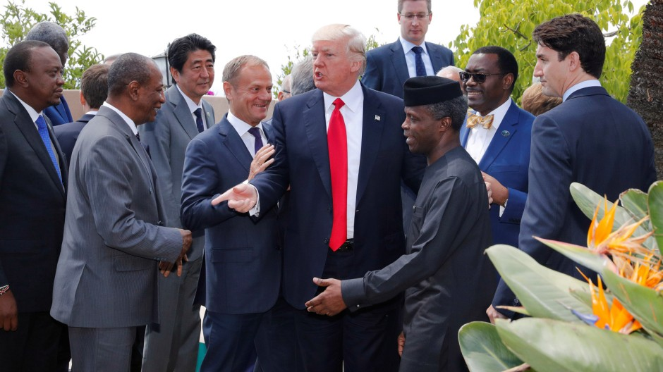 U.S. President Donald Trump poses with African leaders after the family photo at the end of the expanded session at the G7 Summit in Taormina