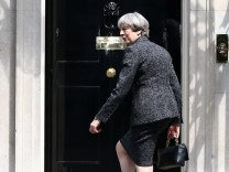 Britain's Prime Minister, Theresa May, arrives at number 10 Downing Street, in London