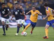 Eintracht Braunschweig's Christoffer Nyman in action with Wolfsburg's Daniel Didavi
