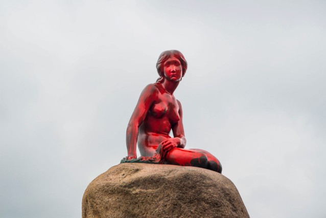 The Little Mermaid statue is seen painted in red in what local authorities say is an act of vandalism, in Copenhagen