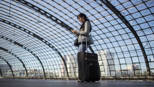 Passenger waits on a platform at Hauptbahnhof station in Berlin
