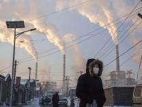 Wenn die USA aus dem Klima-Vertrag aussteigen, könnte China, hier die Stadt Shanxi, beim Emissionshandel profitieren.