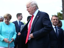 German Chancellor Angela Merkel, U.S. President Donald Trump and French President Emmanuel Macron during a family photo at the G7 Summit expanded session in Taormina