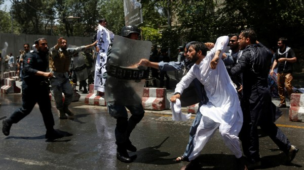 Afghan riot police clash with demonstrators during protest in Kabul