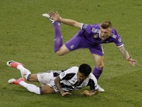 Real Madrid's Toni Kroos in action with Juventus' Dani Alves