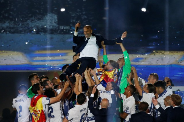 Real Madrid team celebrates at their stadium after winning title