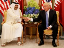 FILE PHOTO: Qatar's Emir Sheikh Tamim Bin Hamad Al-Thani meets with U.S. President Donald Trump in Riyadh