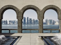 Downtown Doha with its impressive skyline of skyscrapers as seen from the Museum of Islamic Arts ac