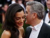 FILE PHOTO: George Clooney and wife Amal Clooney arrive at the Metropolitan Museum of Art Costume Institute Gala 2015 celebrating the opening of 'China: Through the Looking Glass,' in Manhattan
