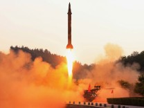 FILE PHOTO: A ballistic rocket is test-fired through a precision control guidance system in this undated photo released by North Korea's Korean Central News Agency
