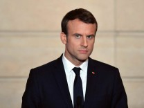 French President Emmanuel Macron attends a press conference after a meeting at the Elysee Palace with Michael Bloomberg in Paris