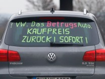 A man drives his Volkswagen Tiguan 2.0 litres TDI Diesel on the A59 motorway near Bonn
