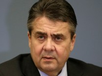 FILE PHOTO: German Foreign minister Sigmar Gabriel listens during a news conference in Riga, Latvia